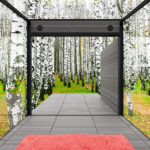 Disappear Retreat by Carly Coulson shows an-all window room overlooking a forest.