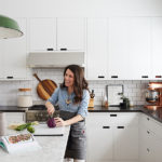 Melissa Coleman's kitchen features neatly organized drawers and minimal cabinets with notches in place of pulls.