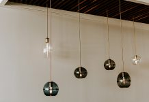 Glass pendants by Hennepin Made hanging from the ceiling.