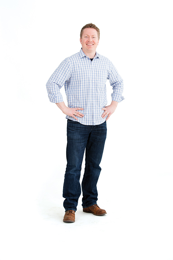Photo of a man standing against a white background