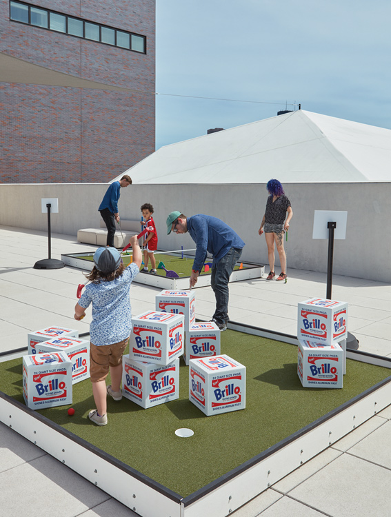 People playing Skyline Mini Golf at the Walker Art Center in Minneapolis, Minnesota.
