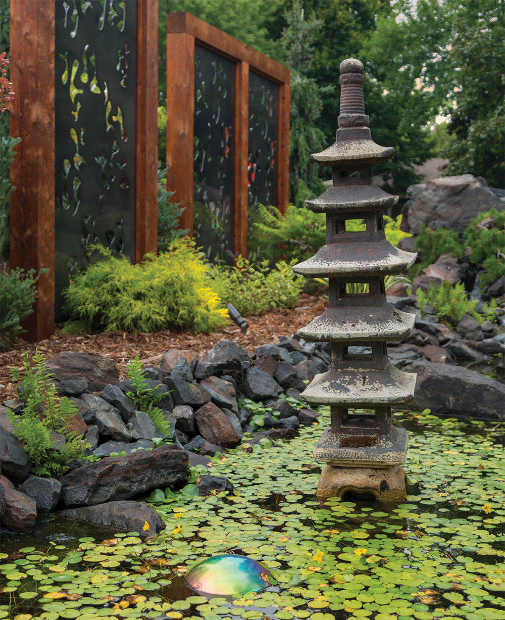 Statues and lanterns imported from Bali reflect the homeowners' affinity for the Indonesian paradise.