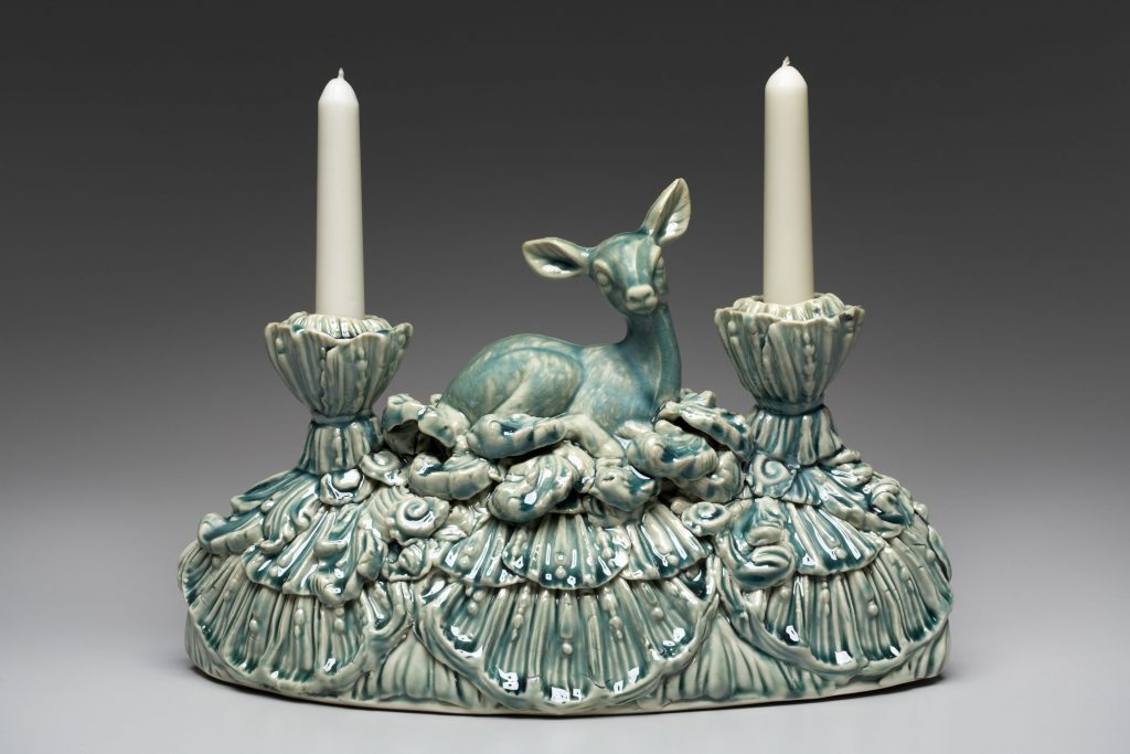 Dual candle holder, in blue green, with deer sitting in grass