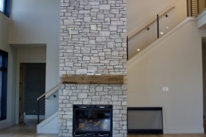 two-story fireplace in Divine Custom Homes' Afton residence