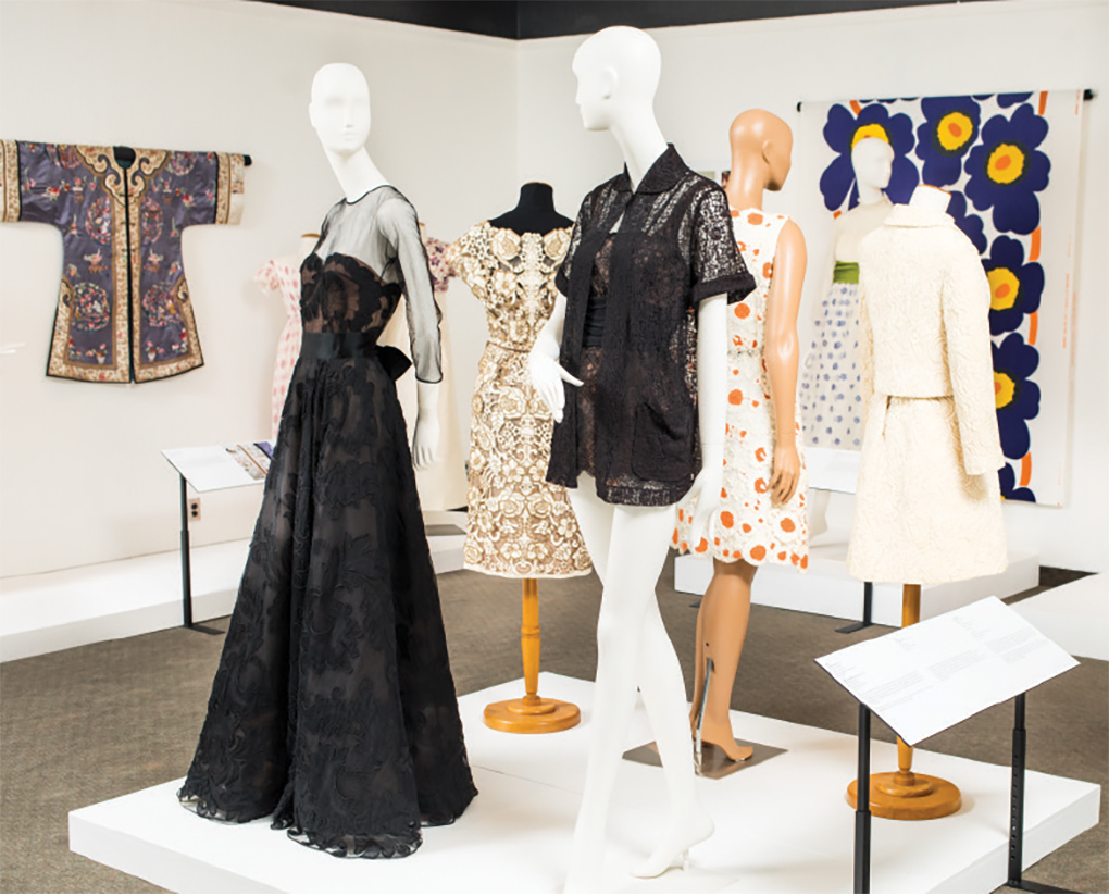 A collection of white and black dresses at the Goldstein Museum of Design.