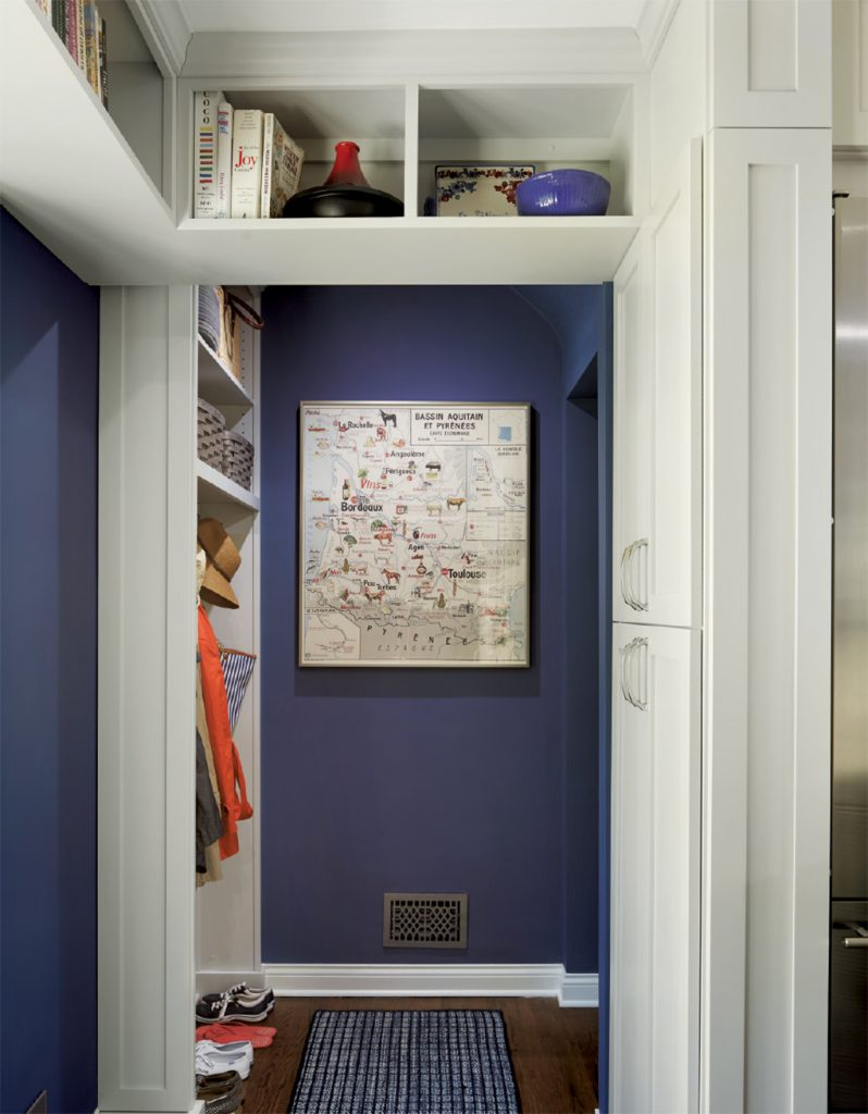 A back storage hall boasts plenty of room for everything in a kitchen remodel by LiLu Interiors.