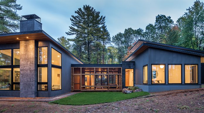 The exterior of a modern north woods home designed by Strand Design.