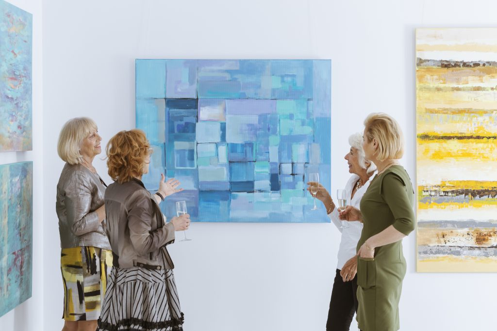 Women looking at art in a gallery