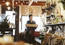 A lady shopping in a boutique shop.