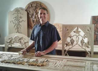 A portrait of Erik Wyckoff in his woodworking shop.