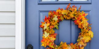 Closeup of front door and decorative autumn wreath