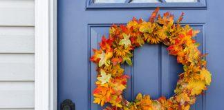 Closeup of front door and decorative autumn wreath