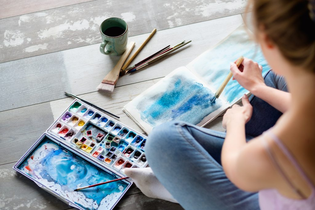 art therapy. painting classes or courses. creativity inspiration expression concept. woman drawing abstract blue painting.