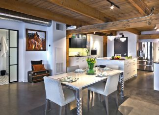 The dining room and kitchen in a room at Partners 4 Design in Minneapolis, one of the stops on Midwest Home's 2018 Luxury Loft and Condo Tour.