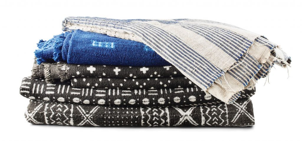 Aso Oke striped textile, $290, Burkina Faso indigo striped woven textile, $145, and Bokolansini mudcloth, $120–$220, Indigo