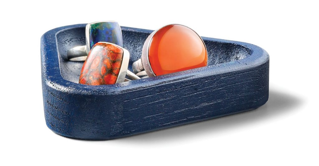Blue wooden triangle dish, $12, The Golden Rule; Carnelian ring, $105, red copper turquoise ring, $68, azurite/malachite ring, $56, Khazan