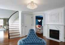 Clean white panels and a glossy dark wood floor provide the perfect backdrop for this elegant, blue-accented space designed by Martha O'Hara Interiors.