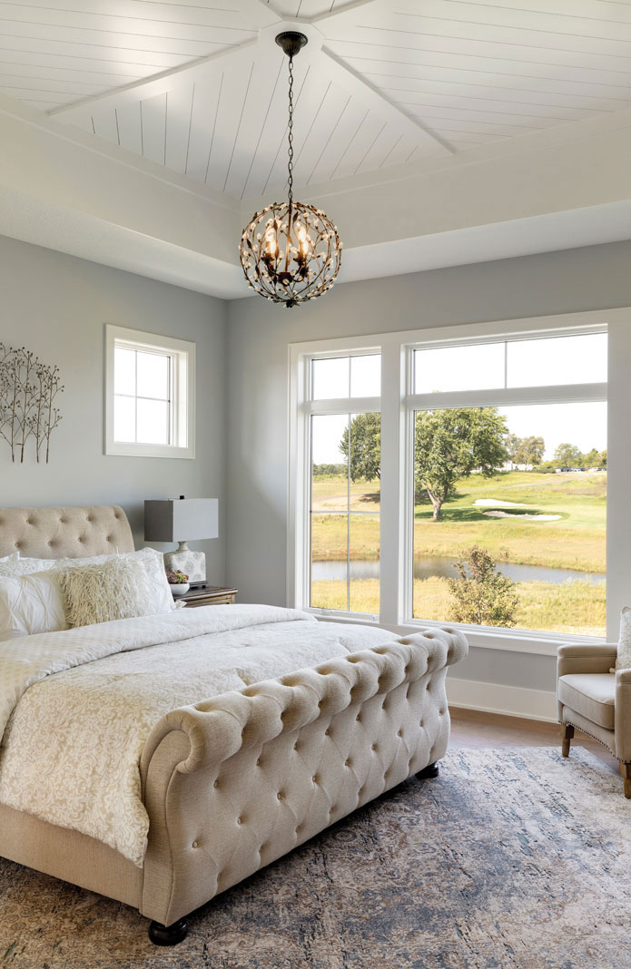 The master bedroom is a study in tranquility, with soft fabrics and muted colors. Part of Midwest Home's 2018 Luxury Home Tour.