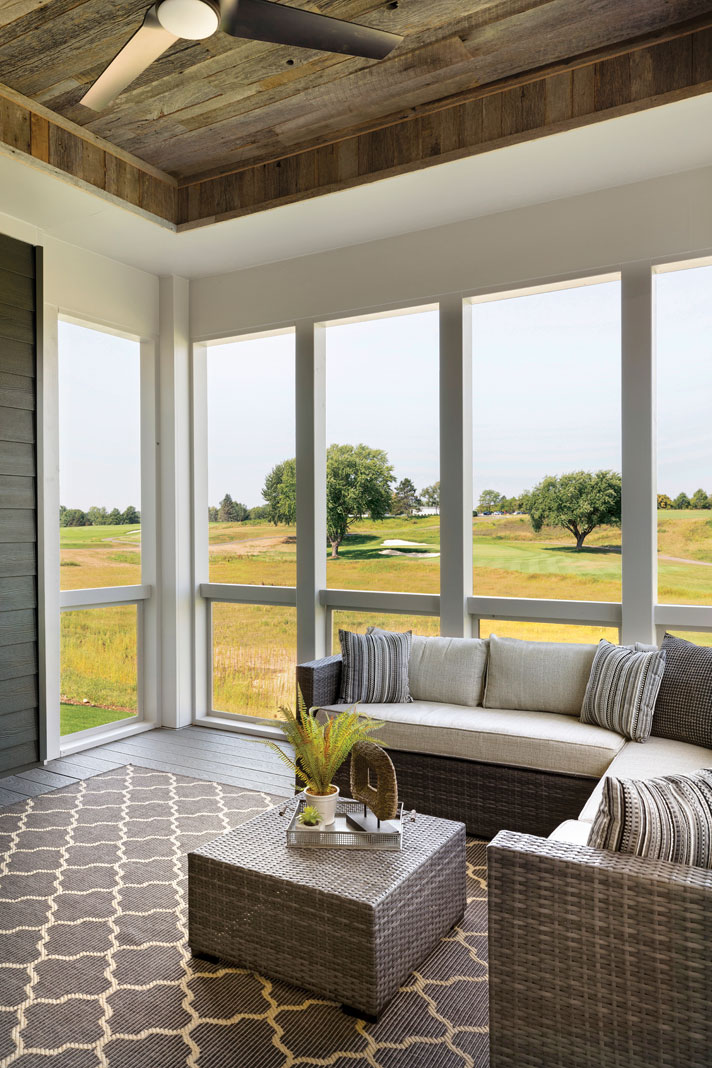 The three-season porch takes full advantage of the views of the surrounding golf course. Part of Midwest Home's 2018 Luxury Home Tour.