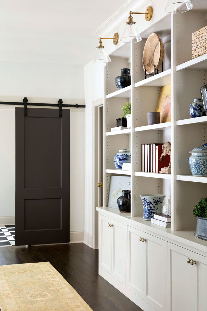 Built-in cabinetry in the upstairs hall provides useful storage space. Part of Midwest Home's 2018 Luxury Home Tour.
