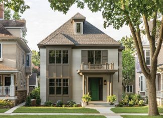 Designed to seamlessly blend in among its historic neighbors, the new home's exterior features double-hung windows and a front portico topped by a balustrade. Part of Midwest Home's 2018 Luxury Home Tour.