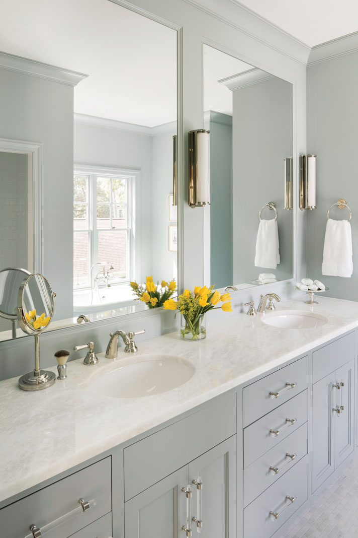 Designed for serenity, the master bath is painted a hazy blue, complementing the putty-colored cabinetry. Part of Midwest Home's 2018 Luxury Home Tour.