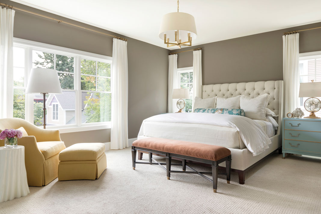 The master bedroom continues the home's palette of rich colors, with accents of turquoise offsetting the deep warmth of the taupe walls. Part of Midwest Home's 2018 Luxury Home Tour.