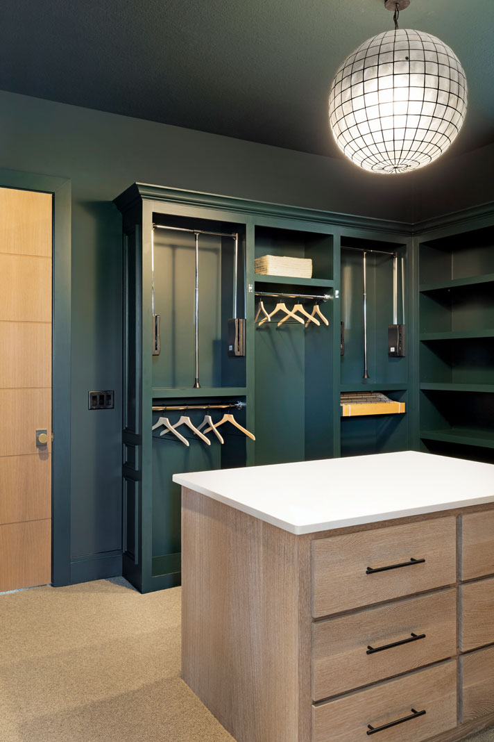 Spacious walk-in closets provide plenty of space for getting ready, and the deep jade color on the walls is continued through accents found in the master bedroom. Part of Midwest Home's 2018 Luxury Home Tour.