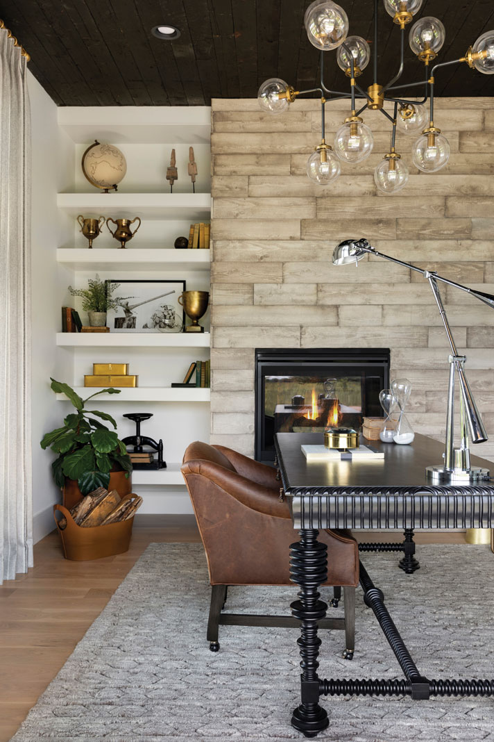 the study's charred-wood ceiling and contemporary chandelier offer a balance of textures within the space. Part of Midwest Home's 2018 Luxury Home Tour.
