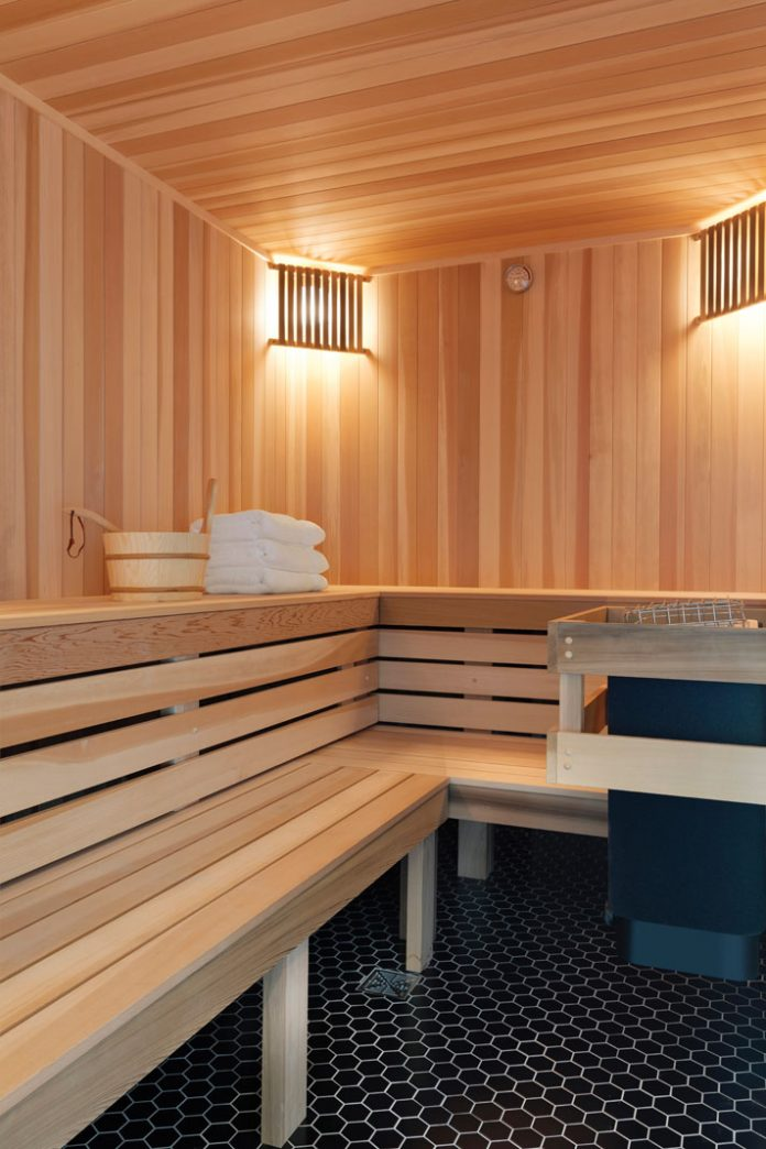 Wood seating in a sauna in a home on Midwest Home's 2018 Luxury Home Tour.