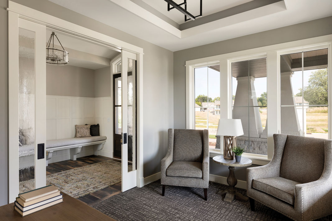 Throughout the home, sliding glass doors create seamless room-to-room transitions. Part of Midwest Home's 2018 Luxury Home Tour.