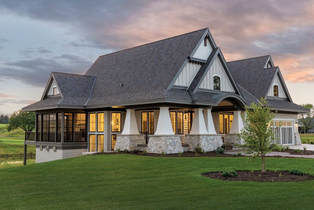 Stately Tapered Columns With Wide Stone Foundations Are A Striking Element  In The Exterior Of This