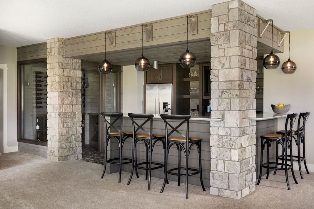 The same stone accents are found in the lower-level bar. Part of Midwest Home's 2018 Luxury Home Tour.