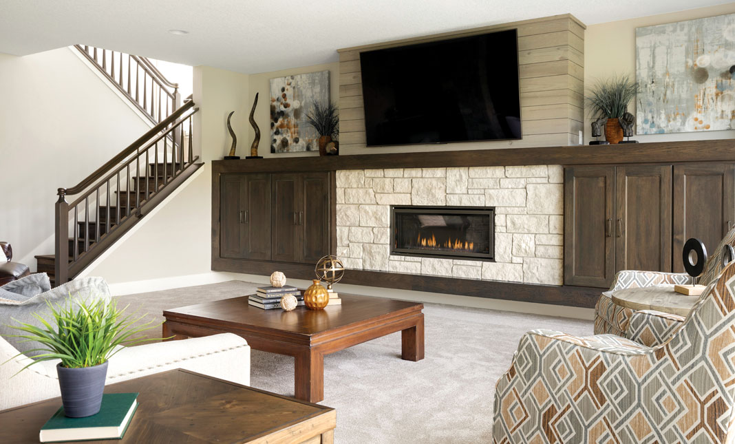 The same stone accents are found in the lower-level seating areas. Part of Midwest Home's 2018 Luxury Home Tour.