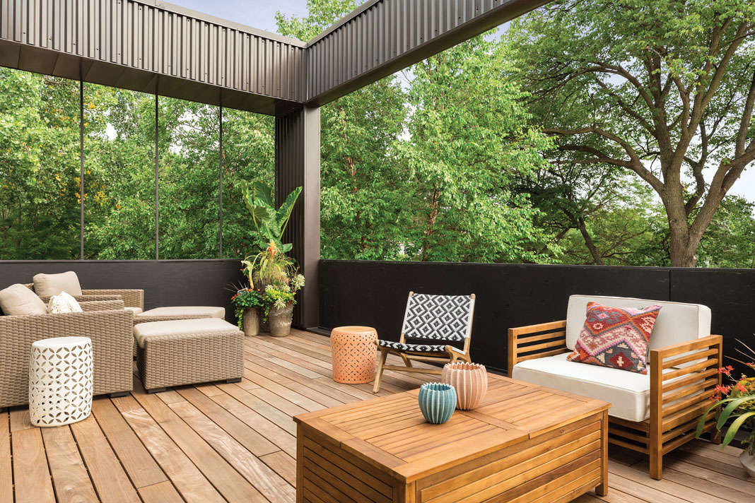 Located off the living room, the balcony features ipe wood decking, a variety of seating options, and a live-edge roof feature. Part of Midwest Home's 2018 Luxury Home Tour.