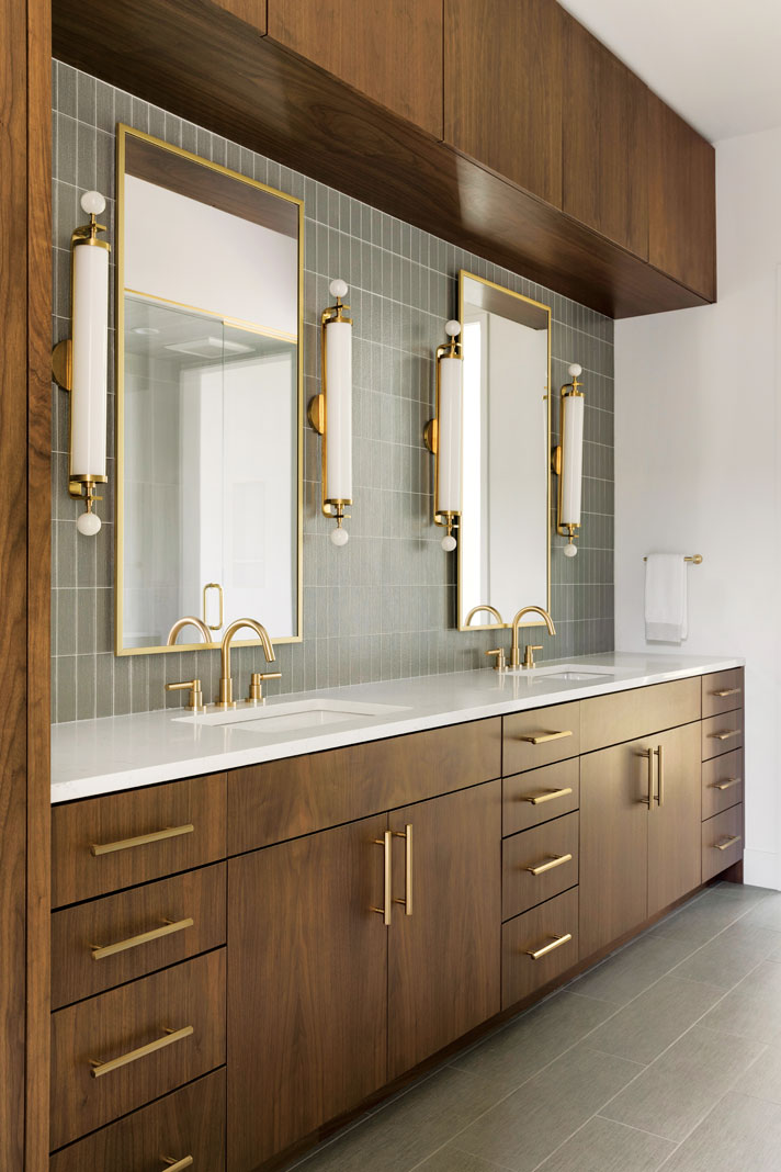 Gold accents add a touch of glam to the natural wood cabinetry used in the master bathroom. Part of Midwest Home's 2018 Luxury Home Tour.