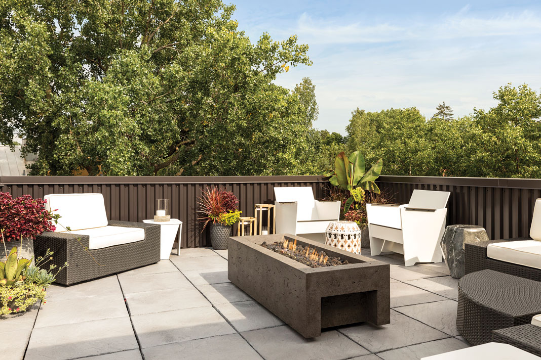 A rooftop's patio features a bluestone terrace that provides an outdoor getaway, with a seating area, gas fireplace, and additional space for the owners to add a garden or hot tub. Part of Midwest Home's 2018 Luxury Home Tour.
