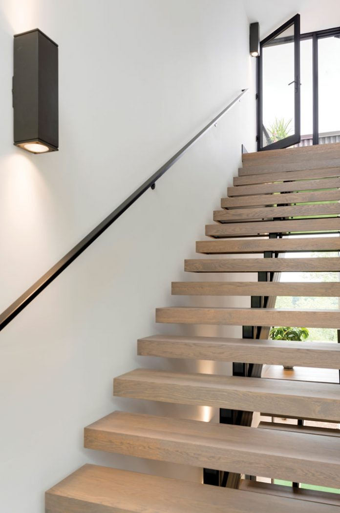 A stairwell connection the lower and upper levels of a home on Midwest Home's 2018 Luxury Home Tour.
