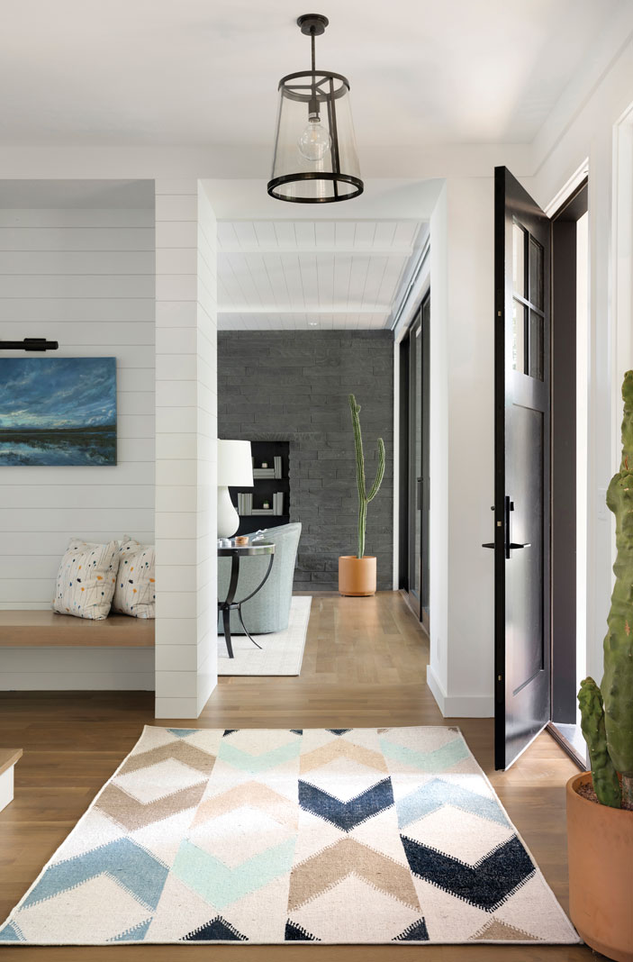 The foyer leads into a series of simple, spacious interiors decorated in neutral tones and understated materials, and each room flows seamlessly into the next to create a relaxed, easygoing atmosphere. Part of Midwest Home's 2018 Luxury Home Tour.