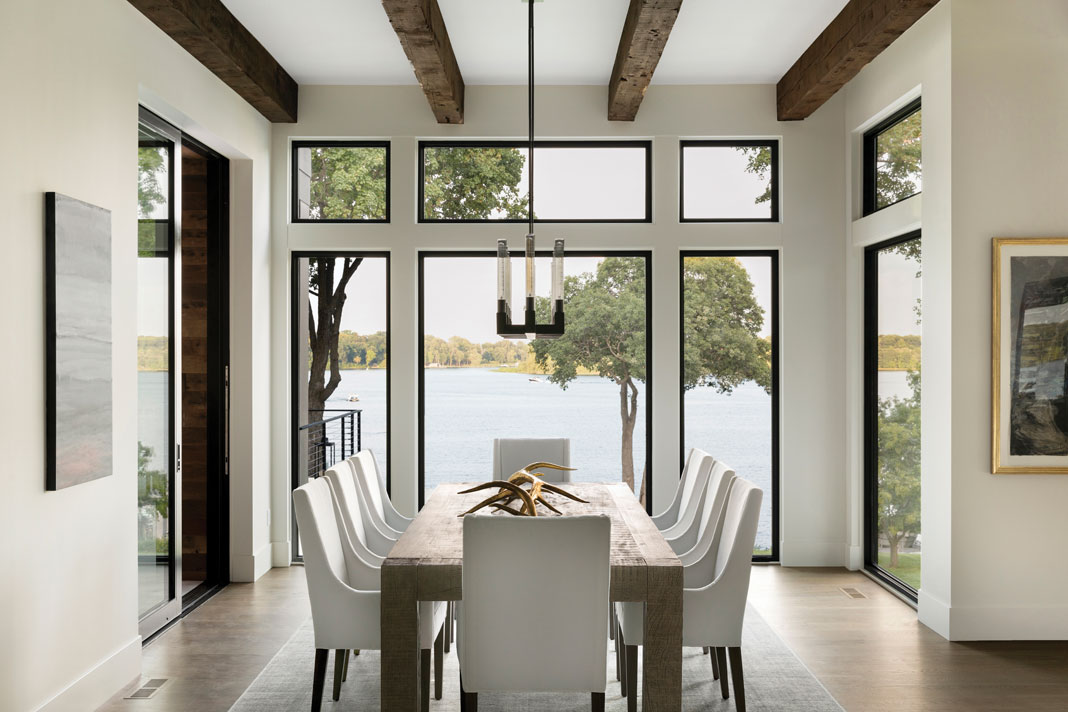 In the dining area, floor-to-ceiling windows provide sprawling views of Maxwell Bay. Part of Midwest Home's 2018 Luxury Home of Tour.