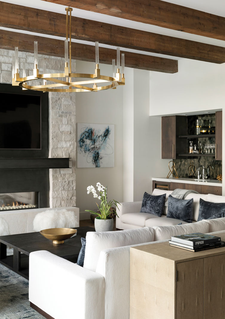 The home's main living space combines modern, upscale details with a distinctly northern feel through the use of metal, glass, and a tone-on-tone palette complemented by reclaimed wood and stone accents. Part of Midwest Home's 2018 Luxury Home Tour.