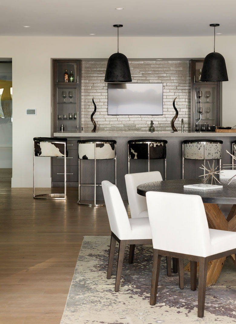 The basement's wet bar provides plenty of seating for entertaining. Part of Midwest Home's 2018 Luxury Home Tour.
