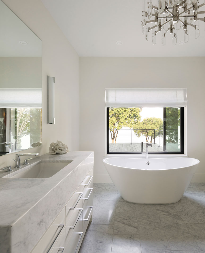 Upstairs, the master bath features elements of stone in its two vanities, along with a strategically placed soaking tub with optimal views of Lake Minnetonka. Part of Midwest Home's 2018 Luxury Home Tour.