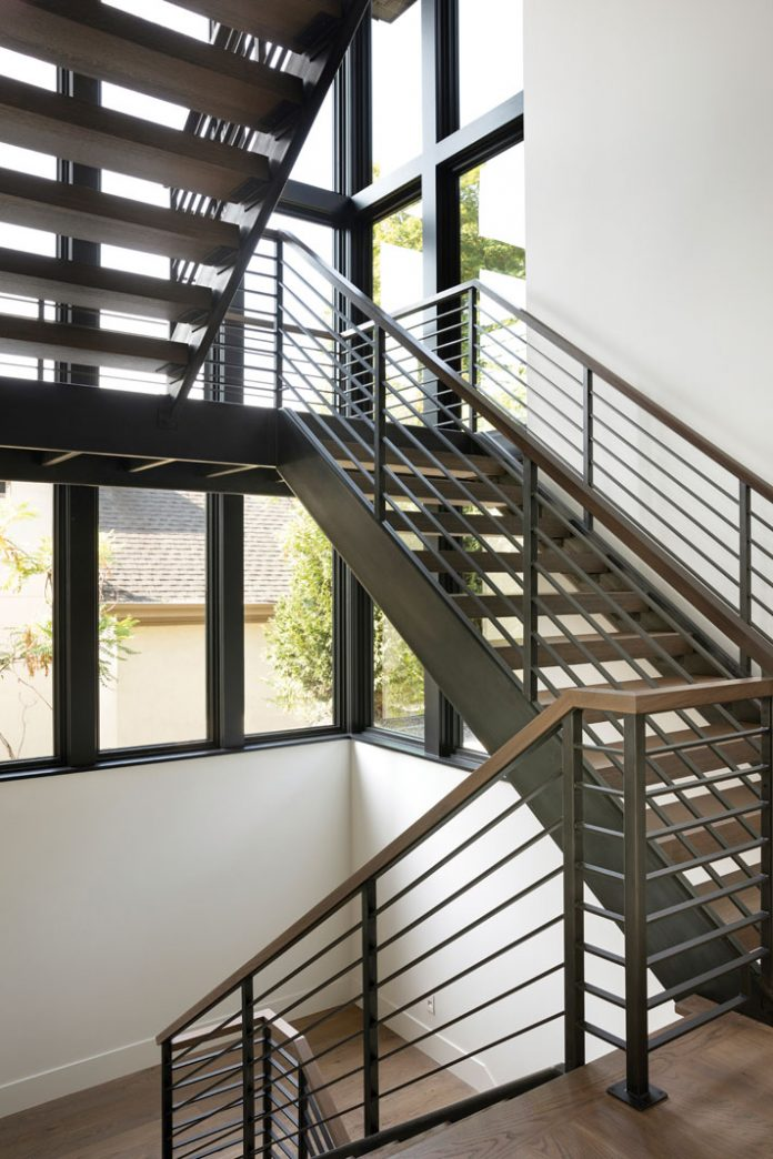 A stairwell linking the lower and upper levels of a home. Part of Midwest Home's 2018 Luxury Home Tour.