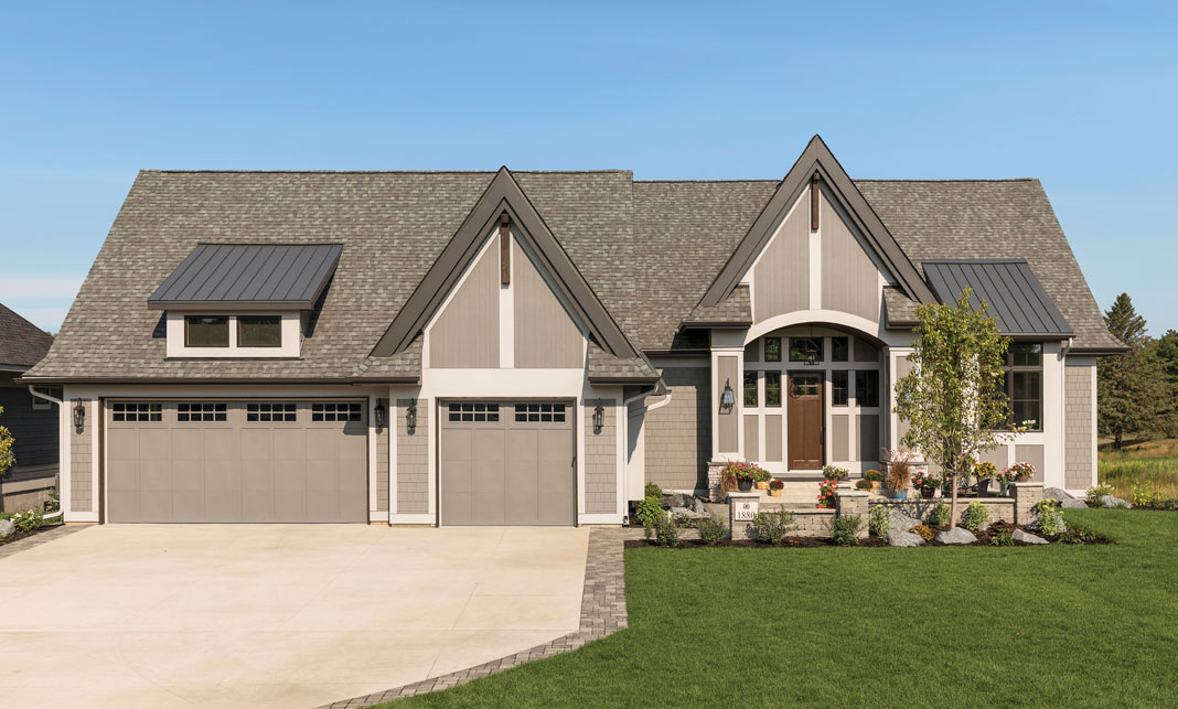 Situated on the edge of the scenic Royal Club championship golf course, the home features a three-car garage and a paver courtyard leading up to the front door. Part of Midwest Home's 2018 Luxury Home Tour.