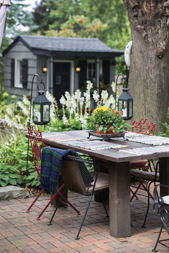 The couple's garden shed is designed to match their home, providing the perfect backdrop to their outdoor retreat.