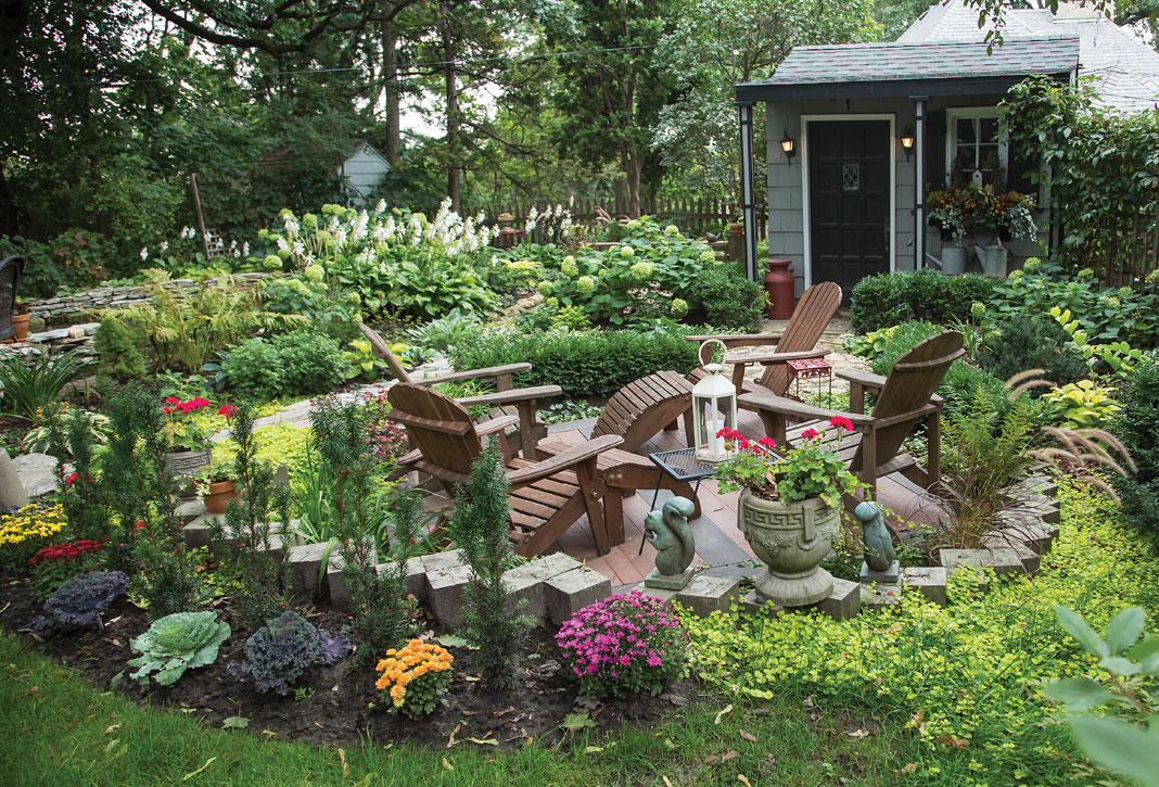 Lounge chairs nestled within the leafy greenery of the garden create an ideal space for relaxation.