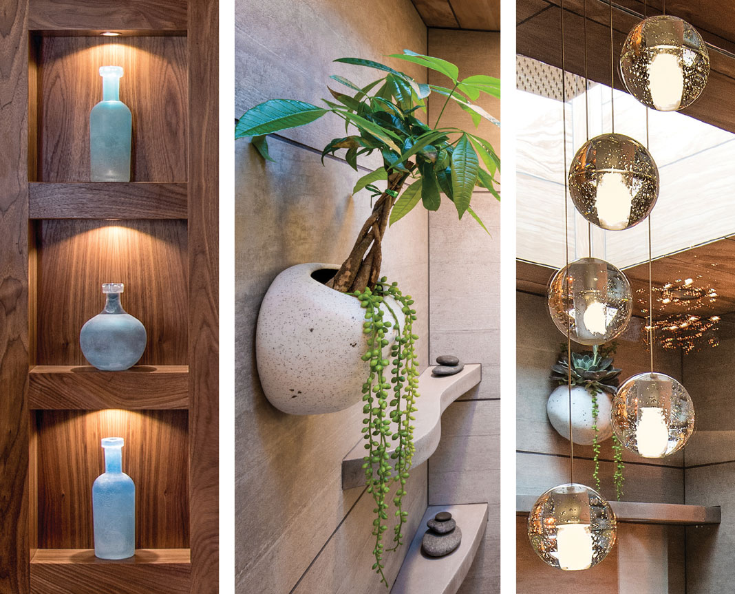 Custom cabinetry, wall planters, and hanging lights add sophistication.