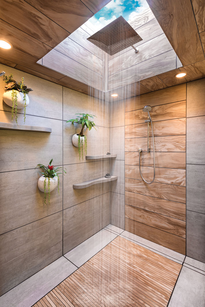 The bath's new design reflects the client's love of Asian style. Highlights are a soothing rain shower, faux-wood accent tiles, and tatami-mat-like flooring.