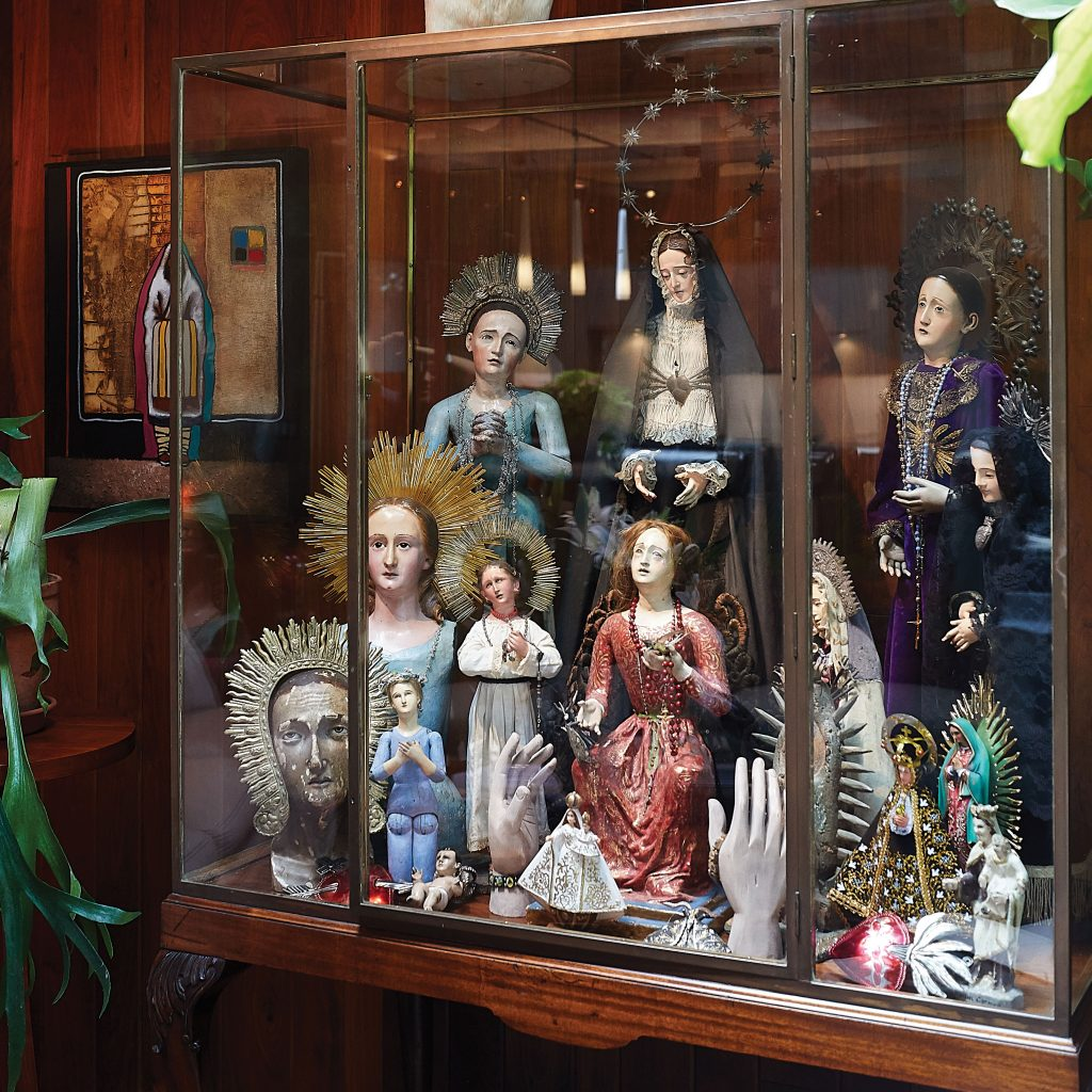 The Isles Studio owner's display of Virgin Mary statuettes features ornate versions hailing from Mexico, Spain, France, and Italy.